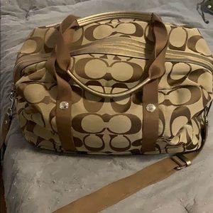 Gold Coach Duffle Bag